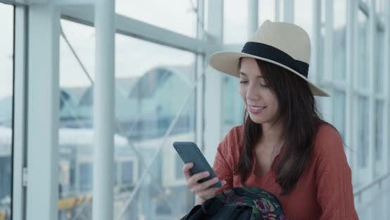 Thumbnail for Woman use of mobile phone in the airport
