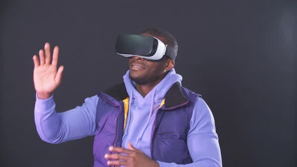 Thumbnail for African-American Man Using Virtual Reality Headset Isolated Over Violet Background