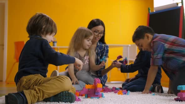 Thumbnail for Carefree Preschool Children Relaxing in Playroom