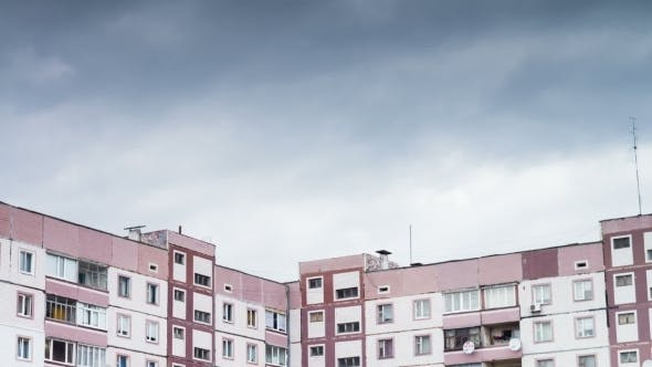 Cover Image for Clouds Moving Over The Multistorey Buildings