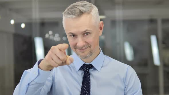 Thumbnail for Inviting Gesture By Grey Hair Businessman