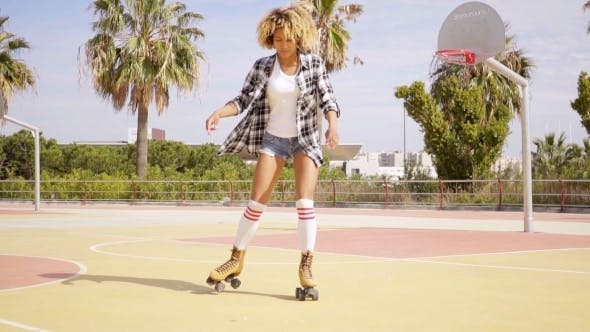 Thumbnail for Woman In Roller Skates On Basketball Court