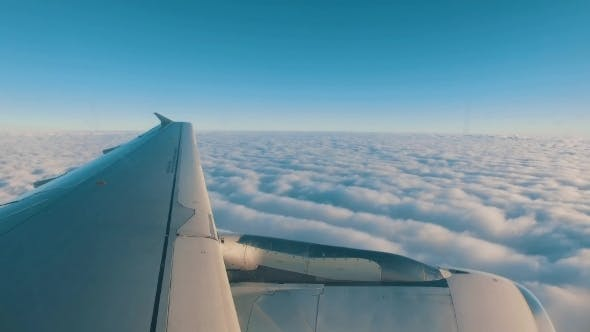 Thumbnail for Airplane Is Flying Above The Clouds