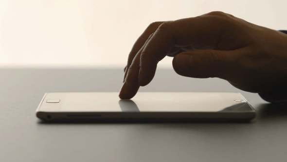Thumbnail for Human Hands Touching On A Tablet PC On A Table