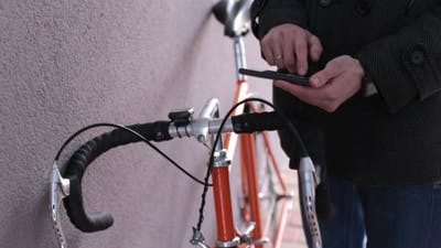 Cyclist with the Phone
