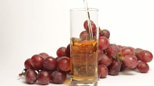 Thumbnail for Grape Juice Being Poured into Glass