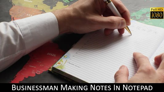 Cover Image for Businessman Making Notes In Notepad