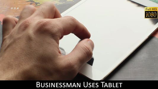 Cover Image for Businessman Uses Tablet