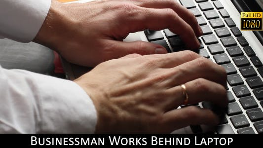 Thumbnail for Businessman Works Behind Laptop 2