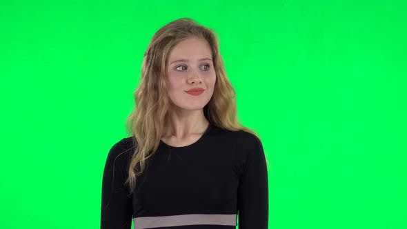 Cover Image for Blonde Girl Looking with Excitement, Then Celebrating Her Victory Triumph. Green Screen