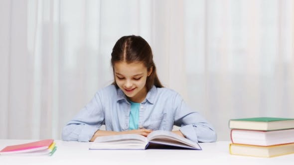 Thumbnail for Happy School Girl Reading Book Or Textbook At Home