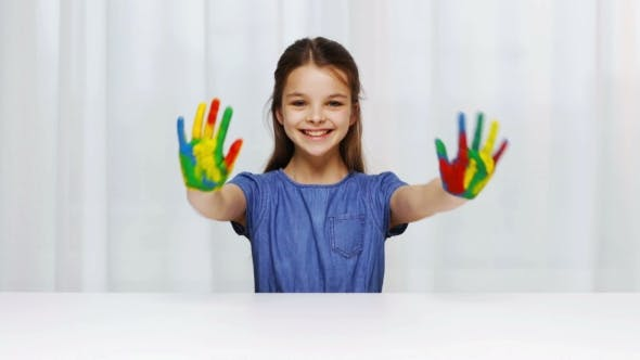 Thumbnail for Smiling Girl Showing Painted Hands