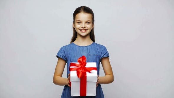 Thumbnail for Happy Smiling Girl Holding Gift Box