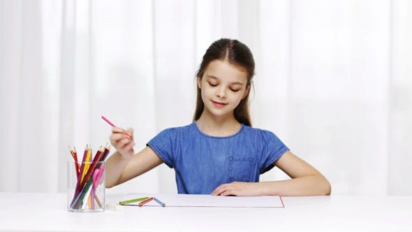 Thumbnail for Happy Girl Drawing With Colour Pencils At Home