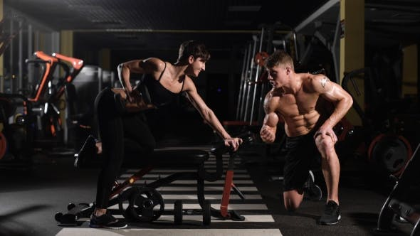 Cover Image for Motivation Gym Woman Pushup With Dumbbell In a Fitness Workout