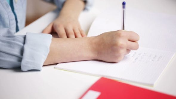 Thumbnail for School Girl Hand Writing Math Task To Notepad