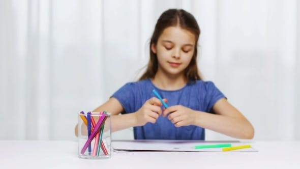 Happy Girl Drawing With Felt-tip Pens At Home