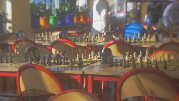 Thumbnail for Kids Are Sitting at the Table on Background Chess