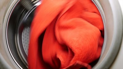 Washing Drying Machine With Red Towel In Laundry