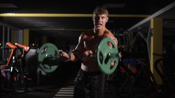 Thumbnail for Motivation Young Adult Bodybuilder Doing Weight Lifting In Gym.