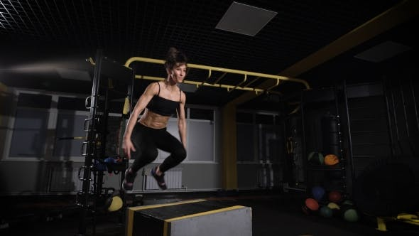 Thumbnail for Young Female Athlete Doing a Box Jump At The Gym