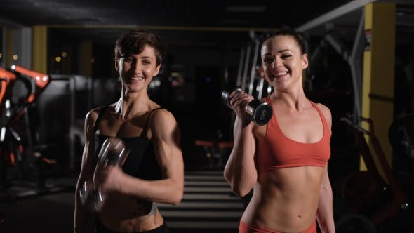 Thumbnail for Two Cute Girls Doing Exercises With Dumbbells.