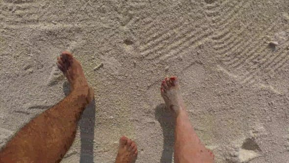 Thumbnail for Couple Feet Walking Along Sandy Beach