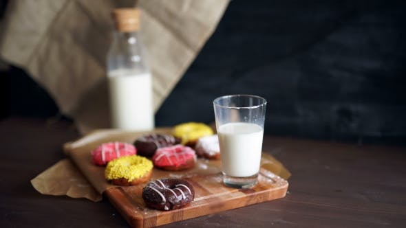 Thumbnail for Doughnut Served With a Mini Bottle Of Milk