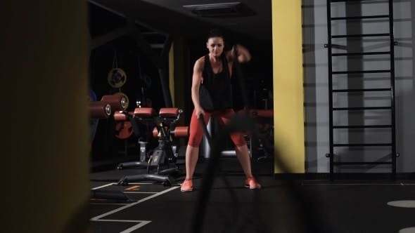 Thumbnail for Athletic Young Woman Doing Some Crossfit Exercises With a Rope