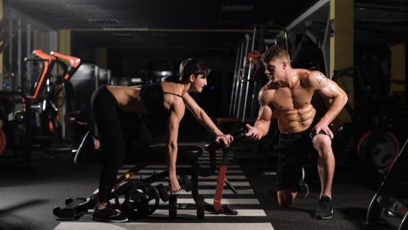 Thumbnail for Gym Woman Push-up Strength With Dumbbell In a Fitness Workout.