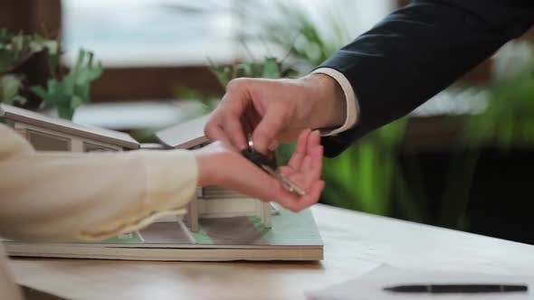 Thumbnail for Business, Real Estate, Deal and People Concept - Man Giving House Keys To Woman at Office.