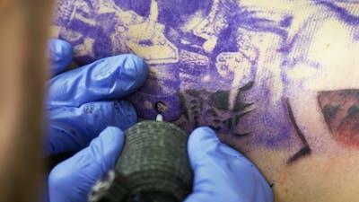 Tattooing On The Body. Tattoo Artist Make Tattoo In Studio