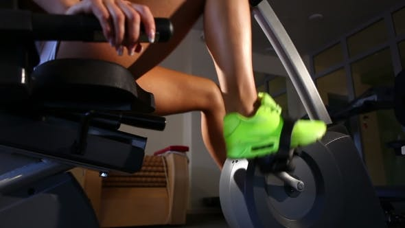 Thumbnail for Female Legs Riding At Stationary Bike In The Gym