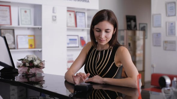 Thumbnail for Young Beautiful Brunette, Paying By Credit Card. Cosmetology Clinic.