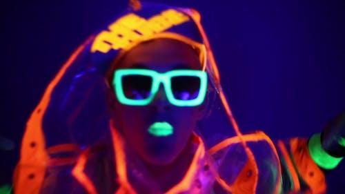 Guy Dancing In Neon Costume