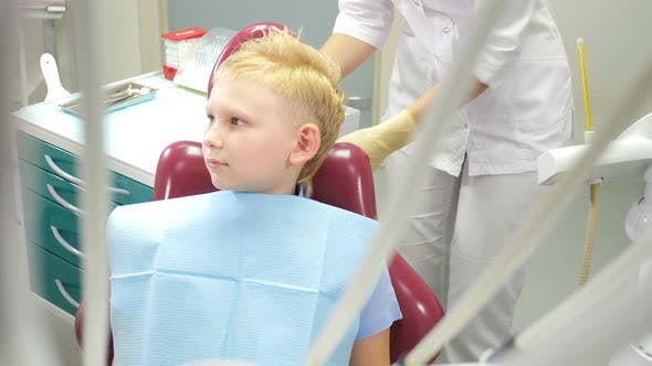Thumbnail for Dentistry Concept. Child Patient Sitting on Dental Chair in Paediatric Dentists Office. Assistant