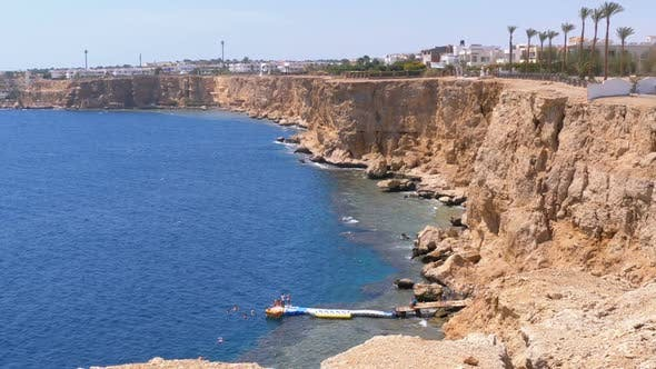 Thumbnail for Rocky Beach in Egypt. Beach in a Bay on the Coastline with Waves in the Red Sea and Coral Reefs