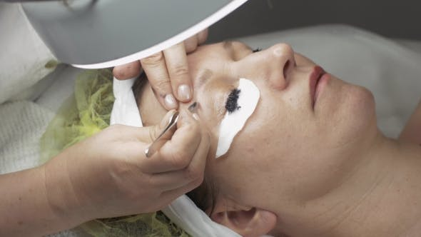 Thumbnail for Cosmetologist Pull Out Eyebrow, While Dyeing Eyelashes To Woman In Beauty Saloon