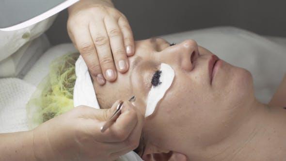 Thumbnail for Cosmetologist Corrects Eyebrow While Dyeing Eyelashes