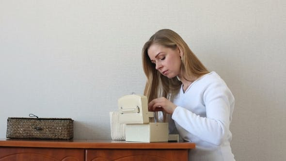 Thumbnail for Beautiful Blonde Woman Looking For Something In Jewelry Boxe