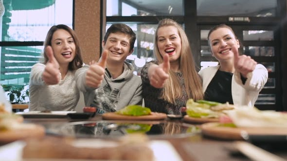 Cover Image for Group Of Friends Showing Thumbs Up In Restaurant