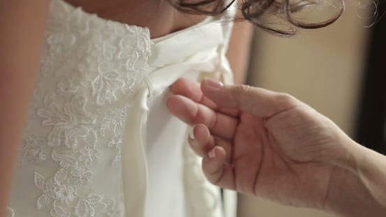 Thumbnail for Bride Putting On Her White Wedding Dress