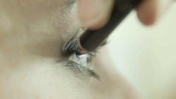 Thumbnail for Makeup Artist Applying Eyeliner On Eyelid