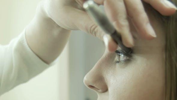 Makeup Artist Applying Eyeliner On Eyelid.