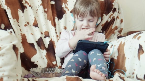 Thumbnail for Little Cute Girl Look Cartoons On Digital Tab