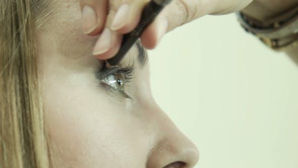 Thumbnail for Makeup Artist Applying Eyeliner On Eyelid.