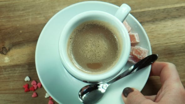 Thumbnail for The Female Puts a Cup Of Coffee On a Table