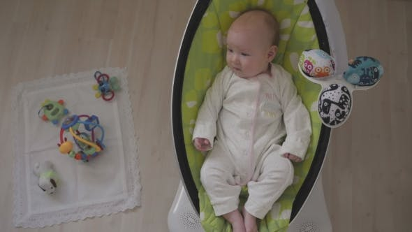 Thumbnail for Happy Little Cute Baby Girl Swing In Electric Chair Bouncer