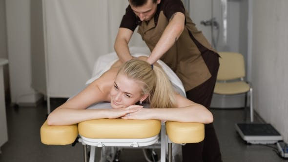 Thumbnail for Young Attractive Blonde Woman Smiling With a Massage