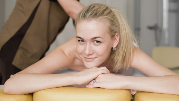 Thumbnail for Young Attractive Girl Smiling With a Massage.